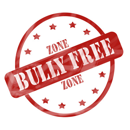 A red ink weathered roughed up circle and stars stamp design with the words BULLY FREE ZONE on it making a great concept. photo