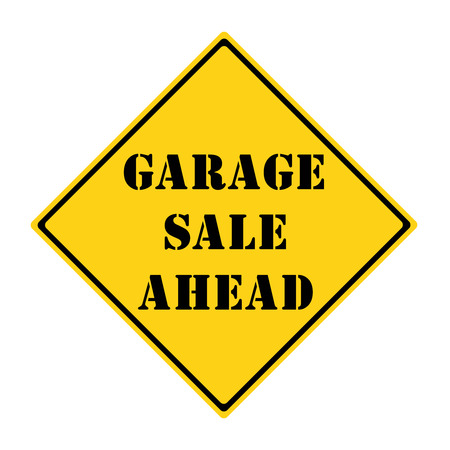 A yellow and black diamond shaped road sign with the words GARAGE SALE AHEAD making a great concept.