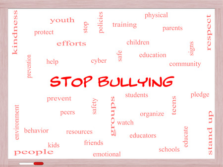 Stop Bullying Word Cloud Concept on a Whiteboard with great terms such as students, cyber, safety and more. photo