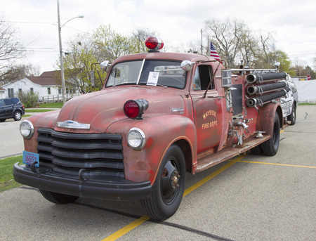 antique fire truck: MENASHA, WI - MAY 16:  1951 Chevy Fire Truck at 7th Annual Car Show May 16, 2014 in Menasha, Wisconsin.