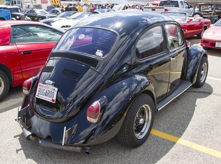 vw: MENASHA, WI - MAY 16:  Black VW Beetle car at 7th Annual Car Show May 16, 2014 in Menasha, Wisconsin.