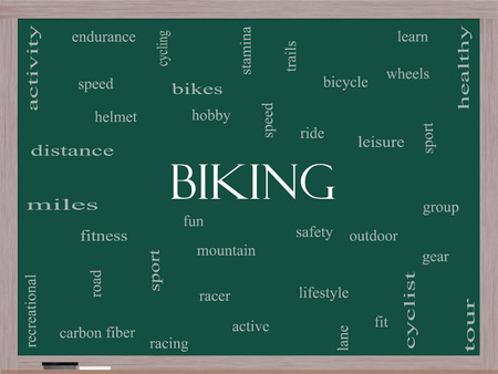 Biking Word Cloud Concept on a Blackboard with great terms such as sport, fitness, ride and more. photo