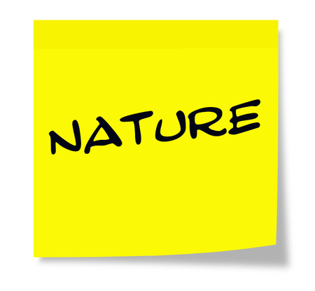 Nature written on a paper yellow Sticky Note making a great concept.