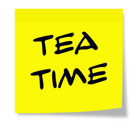 Tea Time written on a paper yellow Sticky Note making a great concept.