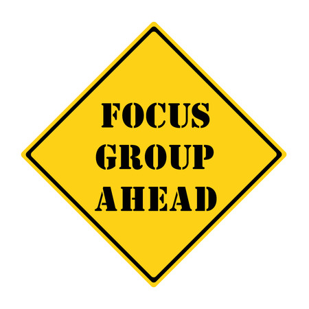 focus group: A yellow and black diamond shaped road sign with the words FOCUS GROUP AHEAD making a great concept.