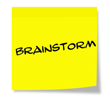 Brainstorm written on a yellow paper Sticky Note making a great concept.