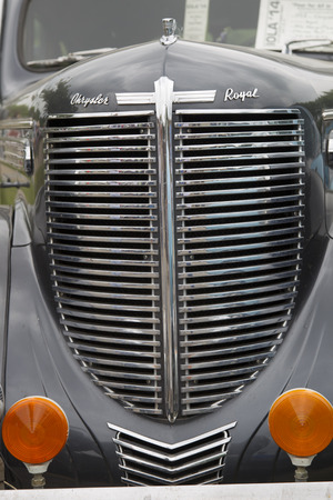 chrysler: IOLA, WI - JULY 12:  Grill of a Black 1938 Chrysler Royal Car at Iola 42nd Annual Car Show July 12, 2014 in Iola, Wisconsin.