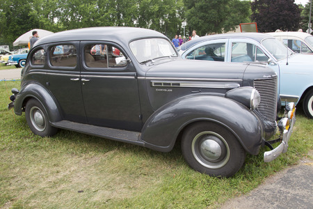 chrysler: IOLA, WI - JULY 12:  Side of a Black 1938 Chrysler Royal Car at Iola 42nd Annual Car Show July 12, 2014 in Iola, Wisconsin.