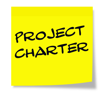 project charter: Project Charter written on a yellow sticky note making a great concept.