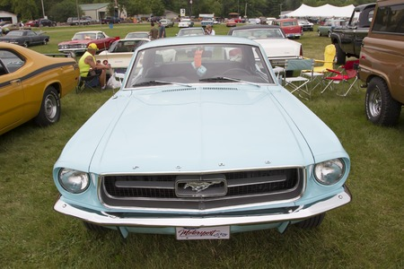 42nd: IOLA, WI - JULY 12:  Front of Powder Blue Ford Mustang car at Iola 42nd Annual Car Show July 12, 2014 in Iola, Wisconsin.
