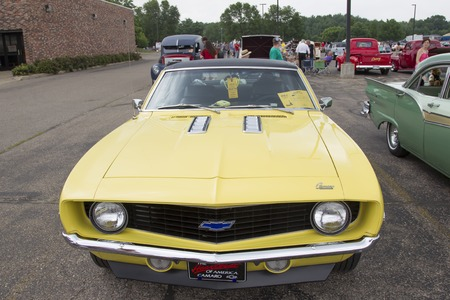 chevy: IOLA, WI - JULY 12:  1969 Yellow Chevy Camaro Car at Iola 42nd Annual Car Show July 12, 2014 in Iola, Wisconsin. Editorial