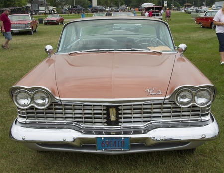 fury: IOLA, WI - JULY 12:  Front of 1959 Plymouth Sport Fury Car at Iola 42nd Annual Car Show July 12, 2014 in Iola, Wisconsin. Editorial