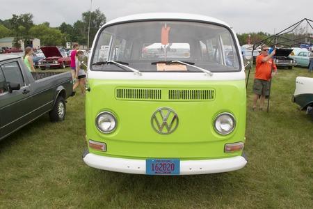 vw: IOLA, WI - JULY 12:  1971 Volkswagen VW Van Green Car at Iola 42nd Annual Car Show July 12, 2014 in Iola, Wisconsin.