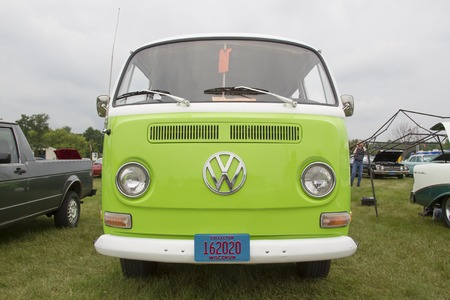 vw: IOLA, WI - JULY 12:  Front of 1971 Volkswagen VW Van Green Car at Iola 42nd Annual Car Show July 12, 2014 in Iola, Wisconsin.