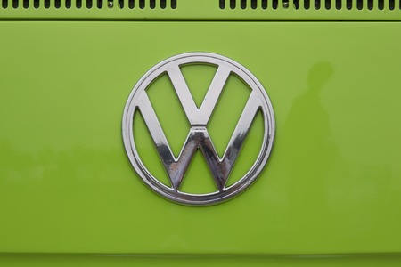 vw: IOLA, WI - JULY 12:  Symbol on 1971 Volkswagen VW Van Green Car at Iola 42nd Annual Car Show July 12, 2014 in Iola, Wisconsin. Editorial