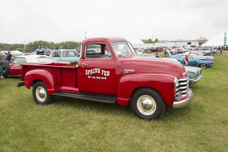 42nd: IOLA, WI - JULY 12:  Side view of Vintage Red Chevy 3600 Pickup Truck at Iola 42nd Annual Car Show July 12, 2014 in Iola, Wisconsin. Editorial