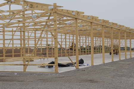 storage unit: Close up of Frame being built for Storage Unit building with lumber in place on concrete pad.