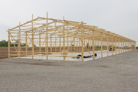 Frame being built for Storage Unit building with lumber in place on concrete pad. Imagens