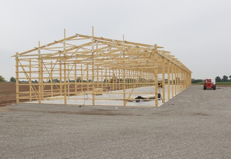 built: Frame being built for Storage Unit building with lumber in place on concrete pad. Stock Photo