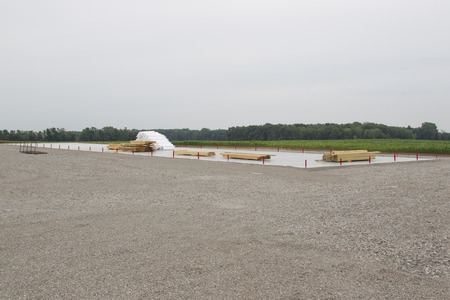 built: Concrete floor and lumber for Storage Unit building being built