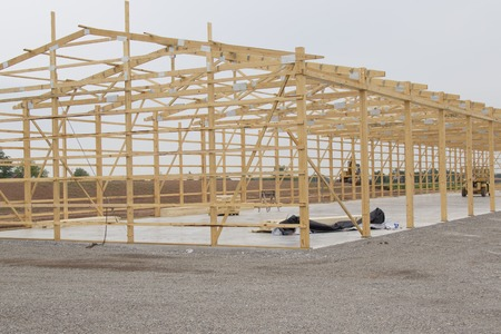 storage unit: Lumber Frame for Storage Unit building under construction with lumber in place on concrete pad.