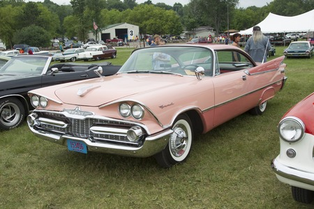 coronet: IOLA, WI - JULY 12:  1959 Pink Dodge Coronet Car at Iola 42nd Annual Car Show July 12, 2014 in Iola, Wisconsin. Editorial