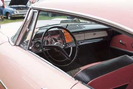 coronet: IOLA, WI - JULY 12:  Interior of 1959 Pink Dodge Coronet Car at Iola 42nd Annual Car Show July 12, 2014 in Iola, Wisconsin.