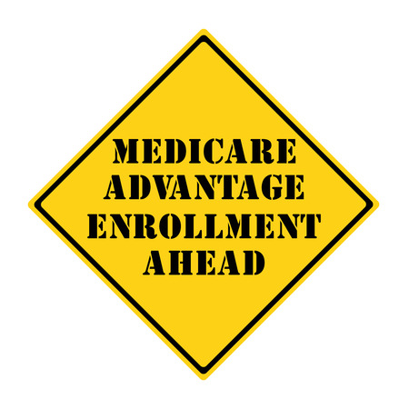 A yellow and black diamond shaped road sign with the words Medicare Advantage Enrollment