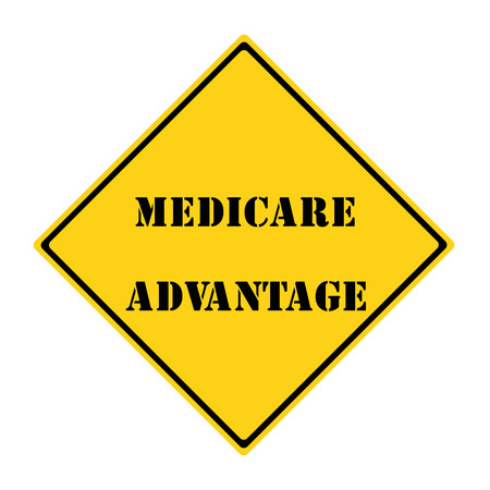 A yellow and black diamond shaped road sign with the words Medicare Advantage making a great concept. Stock Photo