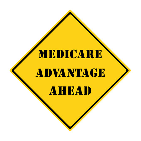 medicare: A yellow and black diamond shaped road sign with the words Medicare Advantage Ahead