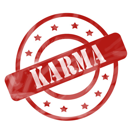 karma: A red ink weathered roughed up circles and stars stamp design with the word KARMA on it making a great concept.