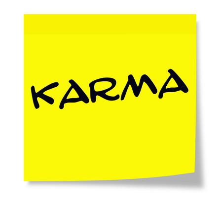 karma: Karma written on a yellow paper Sticky Note making a great concept Stock Photo
