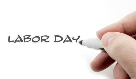 Labor Day Handwriting concept with a males hand and a white marker Stock fotó