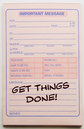 Get things done written on a pink Important Message note pad.