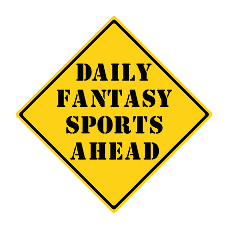 diamond shaped: A yellow and black diamond shaped road sign with the words DAILY FANTASY SPORTS AHEAD making a great concept. Stock Photo
