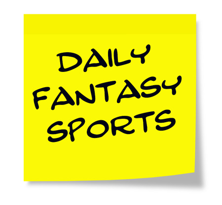 Daily Fantasy Sports written on a yellow sticky note making a great concept. Reklamní fotografie - 47924878