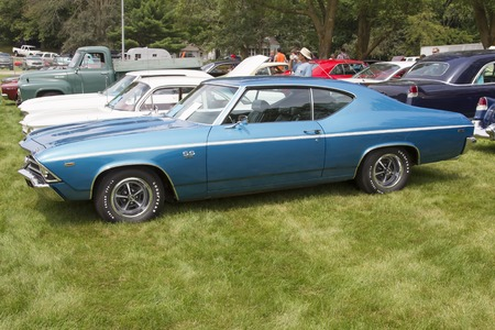chevy: IOLA, WI - JULY 11:  Side of 1969 Chevy SS-396 Sport Coupe car at Iola 43nd Annual Car Show July 11, 2015 in Iola, Wisconsin. Editorial