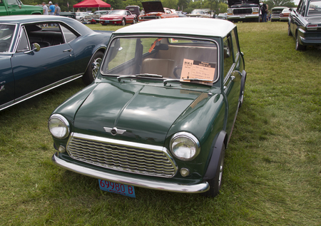 mini car: IOLA, WI - JULY 11:  1981 Green Mini Car at Iola 43nd Annual Car Show July 11, 2015 in Iola, Wisconsin.