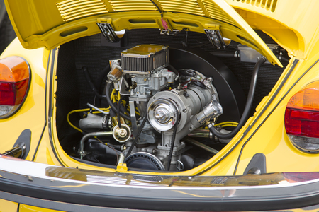 vw: IOLA, WI - JULY 11:  Engine of 1976 VW Yellow Bug  Beetle Car at Iola 43nd Annual Car Show July 11, 2015 in Iola, Wisconsin.