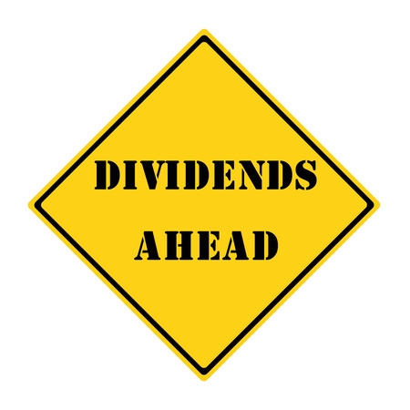 dividends: A yellow and black diamond shaped road sign with the words DIVIDENDS AHEAD making a great concept.