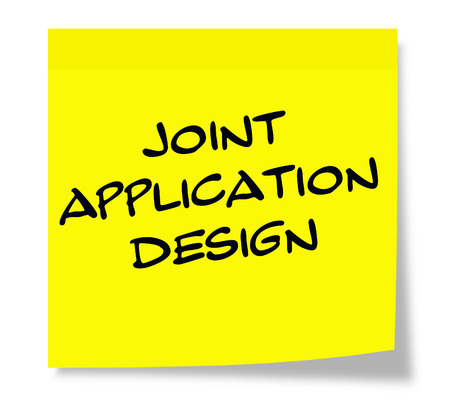 Joint Application Design written on a square yellow sticky note Imagens
