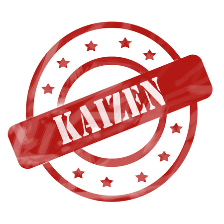 A red ink weathered roughed up circles and stars stamp design with the word Kaizen on it making a great concept.