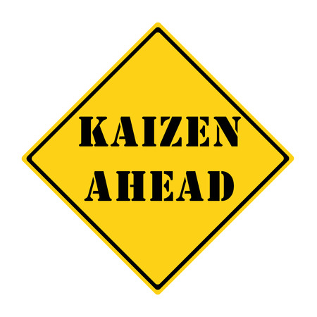 A yellow and black diamond shaped road sign with the words KAIZEN AHEAD making a great concept.