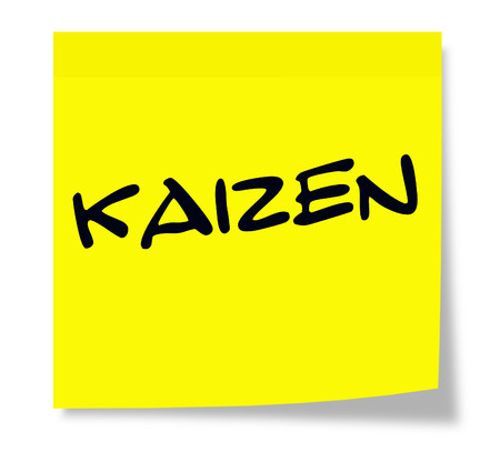 Kaizen written on a yellow sticky note making a great concept.