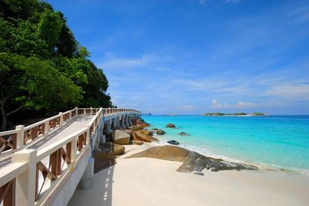 Walkway bridge near the beautiful beach Stock Photo