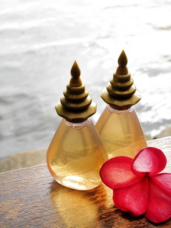 Spa Concept  bottles of essential oil   frangipani flower  photo