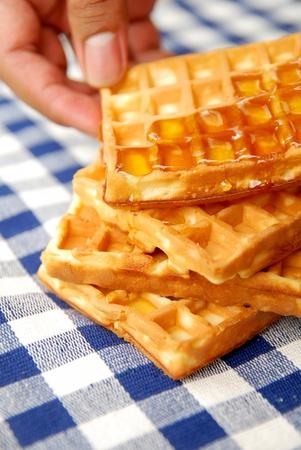 Hand holding waffle photo