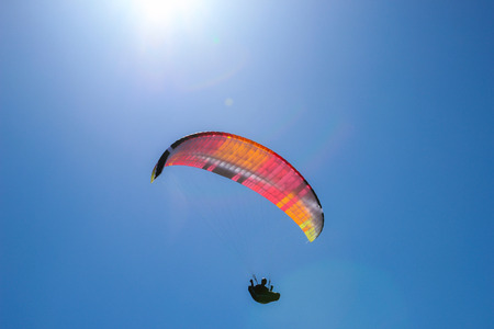 Silhouette of para glider flying in the sky Stock Photo