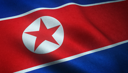 Realistic flag of North Korea waving with highly detailed fabric texture.