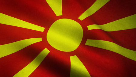 Realistic flag of Macedonia waving with highly detailed fabric texture. Stock Photo